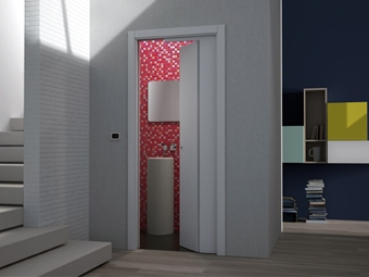 Puerta seccional para espacios reducidos